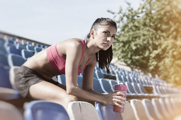 Portrait of a pretty young woman resting after workout