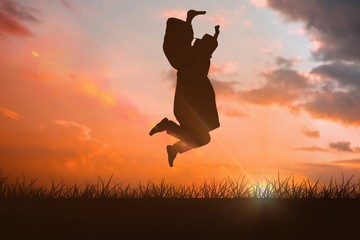 Composite image of happy male student in graduate robe jumping