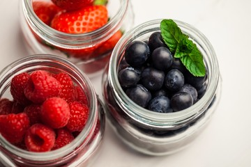 Glass jars of fresh berries
