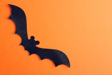 Halloween, bat on orange background