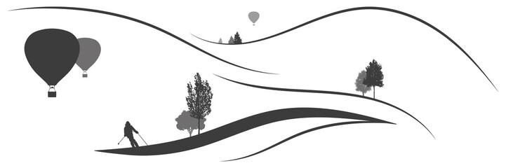 Panorama Berglandschaft mit Skifahrer und Heißluftballons