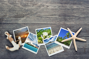 seaside snapshots, anchor and starfish on wooden background