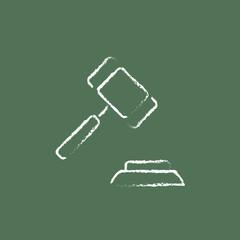 Auction gavel icon drawn in chalk.