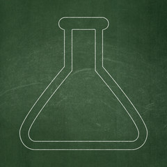 Science concept: Flask on chalkboard background