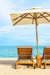 Papiers peints Plage Umbrella and beach chair