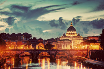 St. Peter's Basilica, Vatican City.  Tiber river in Rome, Italy at late sunset, evening.
