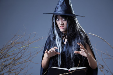 young witch casting a spell