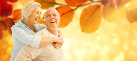 Composite image of happy mature couple smiling at each other