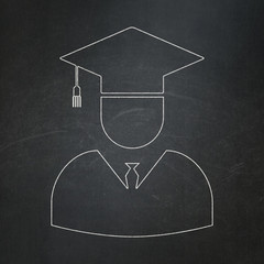 Science concept: Student on chalkboard background