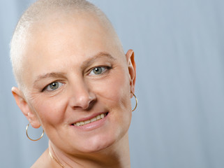 Portrait of happy cancer survivor in studio after successful chemotherapy