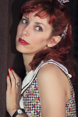 pinup young woman in vintage style clothing