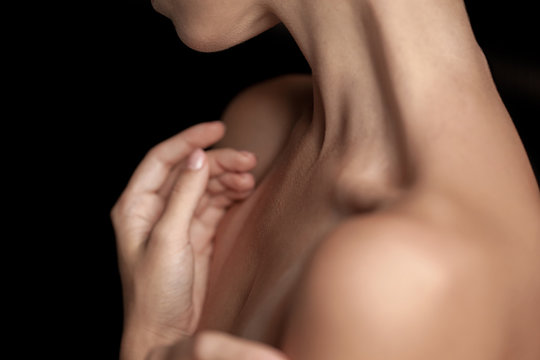 The close-up of a young woman's neck