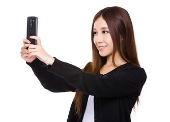 Woman take selfie photo by mobile phone