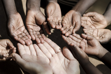 Caucasian and African Ethnicity Hands Asking for Help Symbol