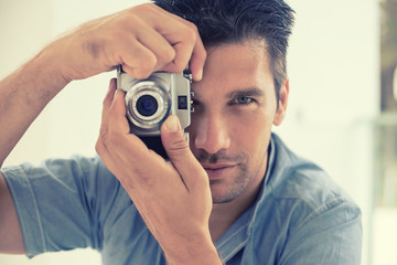 Portrait of man using photo camera