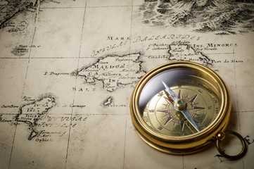 Wall Mural - Old compass on vintage map. Retro stale.