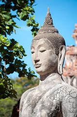 Closeup of a stone Buddha statue at Wat Mahathat temple, Ayutthaya, Thailand