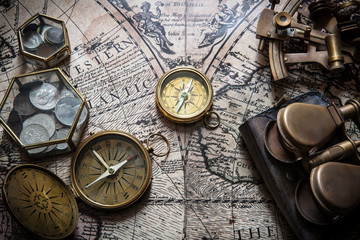 Fototapete - Old compass, astrolabe on vintage map. Retro style.