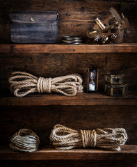 Fototapete - scientific expedition background. The traveller's accessories on the wooden shelf