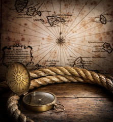Fototapete - old compass and rope on vintage map