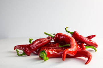 hot red peppers on a white background