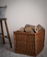Logs In Wicker Basket