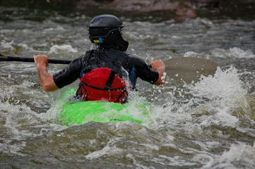 Kayaker training on a rough water. Southern Bug river, Ukraine.