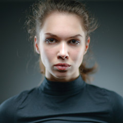 Portrait of a normal girl looking camera. / Beautiful woman port