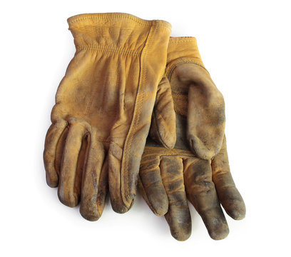 A pair of old used leather working gloves. Pure white background, soft shadows.
