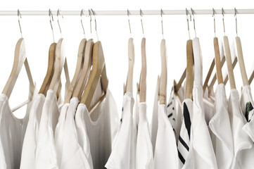 white clothes on hangers close up