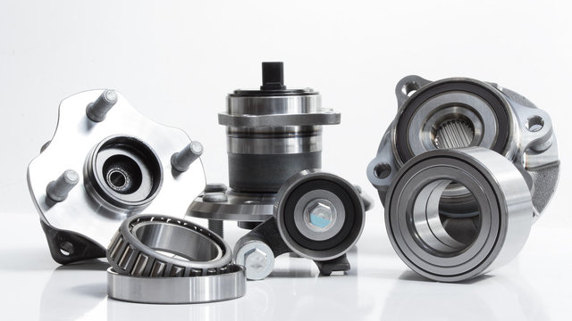 various Friction bearings lie on a gray background