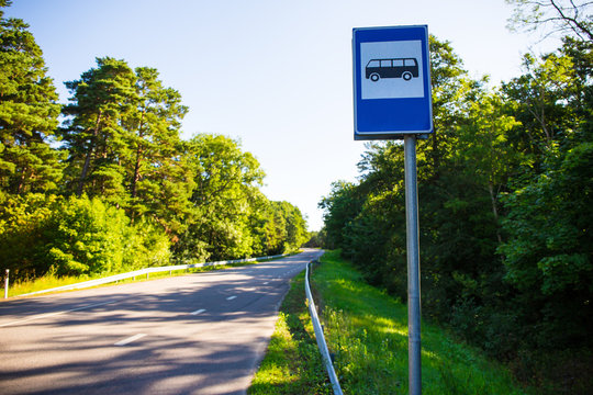 travel concept - bus stop on forest road
