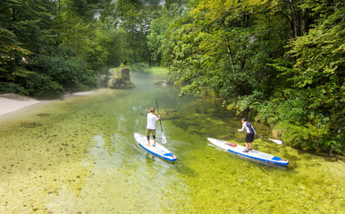 Couple on stand up paddle board in the river, SUP