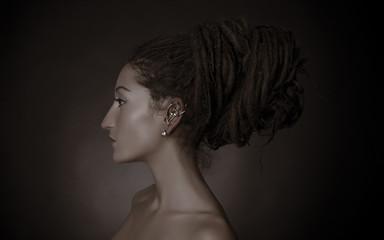 Nefertiti, stylized fashion shoot. Woman with a dreadlocks bun