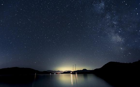 Stars and boats at night