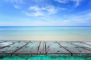 Empty top of wooden table and view of tropical beach background