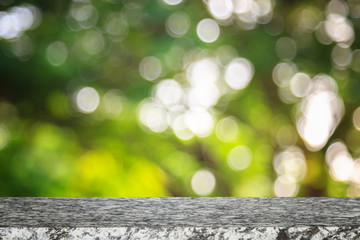 Empty top stone table and sunny abstract blurred bokeh