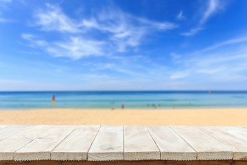 Empty top of wooden table or counter and view of tropical beach