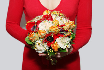 A bouquet of flowers in girl's hands