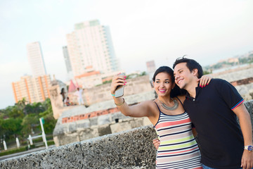 couple taking a selfie in Cartagena, Colombia.