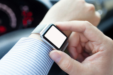 man driving car and watch with isolated screen on the hand