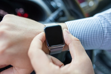 man driving a car with watch on the hand
