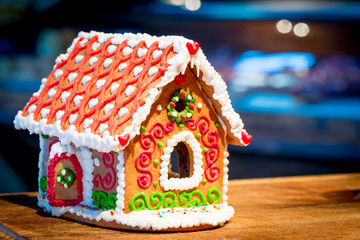 gingerbread house stands on a wooden table