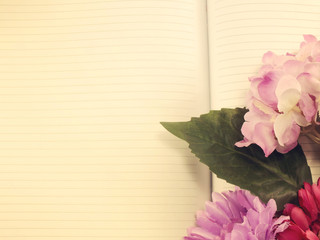 note book diary and beautiful flower bouqet with vintage filter instragram effect;