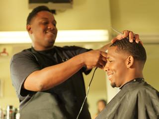 man getting his hair cut at barber shop