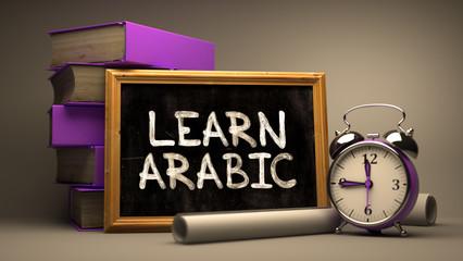 Hand Drawn Learn Arabic Concept on Chalkboard.
