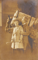 romantic couple of woman and man with horses