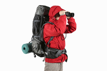 tourist in red jacket with backpack looking through binoculars