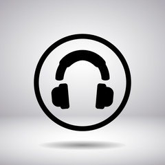Headphones silhouette in a circle