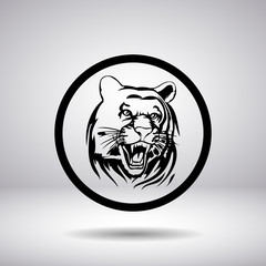 Silhouette of tiger head in a circle